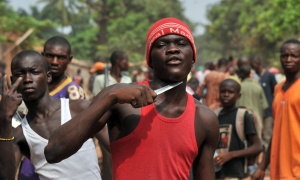 A man holds a knife to his throat claiming that he is looking for Muslims to cut off their heads in the 5th district of Bangui on February 9, 2014. According to witnesses, at least ten people have been killed since the night before in central Bangui, and many buildings burned, after violence broke out near the district hall of Bangui's 5th district. Large-scale looting was also taking place in the same neighbourhood  in the morning of February 9 despite the deployment of French troops and Central African gendarmes. The International Criminal Court in the Hague said on February 7 it had opened an initial probe into war crimes in the Central African Republic.   AFP PHOTO/ ISSOUF SANOGOISSOUF SANOGO/AFP/Getty Images